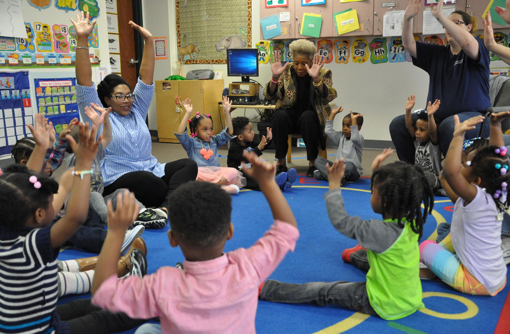 Teaching Artist in classroom interacting with students