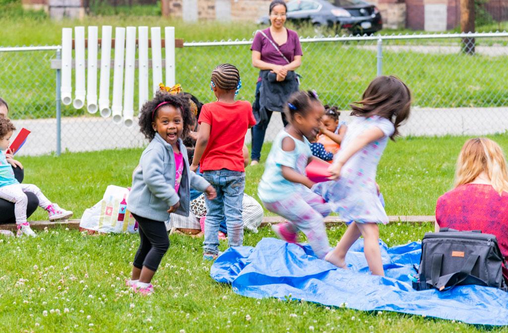 Happy children participate in BuzzWord